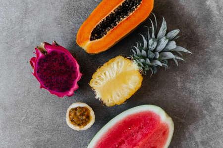 Fresh healthy tropical fruits, melon, pineapple, mango, dragon fruit.