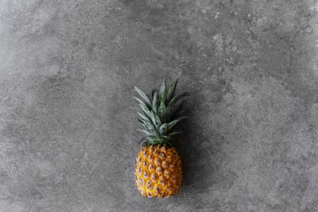 Pineapple on a stone table. Tropical Fruits.