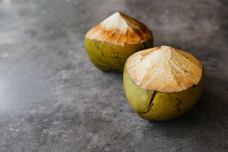 The young coconut is tasty for drinking juice on stone background