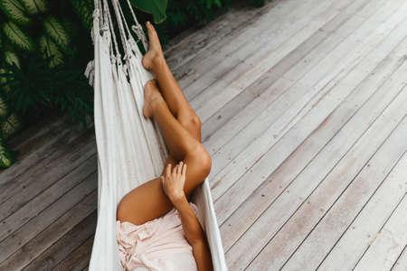 Young beautiful woman relaxing in hammock
