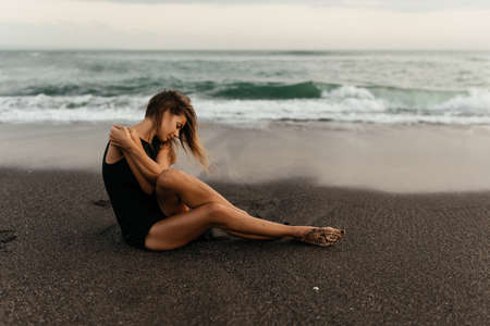 woman on beach is enjoying serene ocean nature during travel holidays vacation outdoors