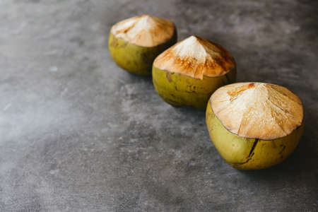 The young coconut is tasty for drinking juice on stone background Standard-Bild