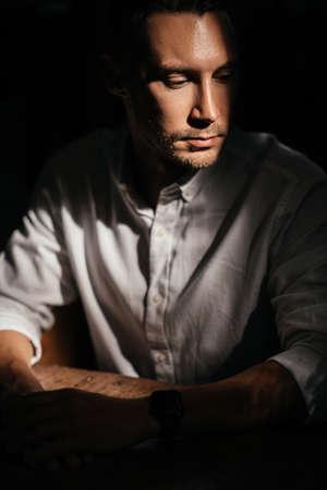 portrait of handsome man sitting in cafe