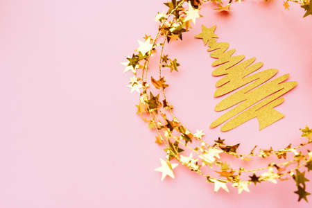 Golden and white glitter decoration and pink background.