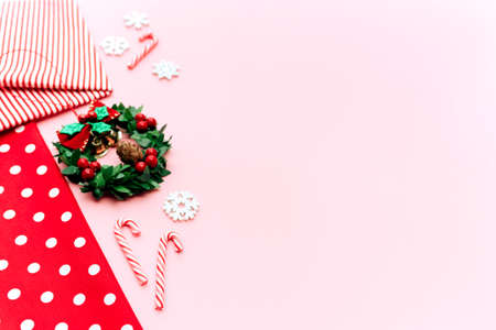 Christmas composition. Christmas gifts, pine branches, toys on pink background.