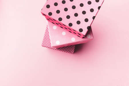 Gift boxs on paste pink background.