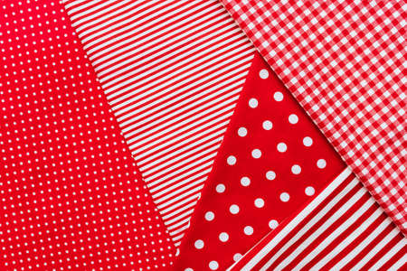 Background from a natural fabric in a red and white colors Imagens