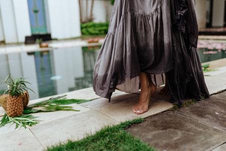 Woman legs in tropical villa