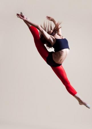 modern ballet dancer dancing on the white studio background photo