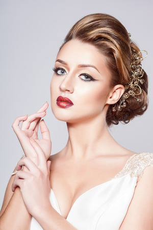 Beautiful bride with fashion hairstyle and make-up photo
