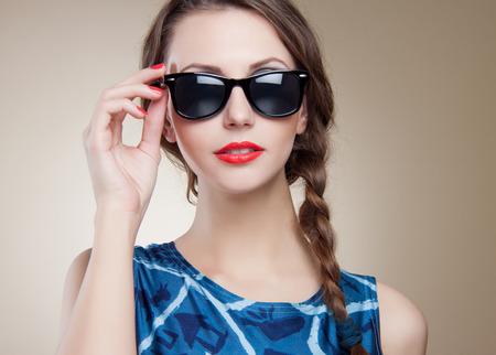 elegance fashion girls look sensuality young: beautiful and fashion girl in sunglasses, close-up portrait, studio shot Stock Photo