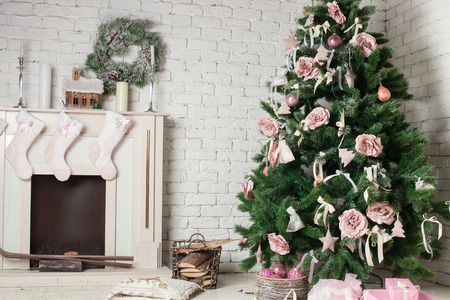 Image of chimney and decorated xmas tree with gift photo