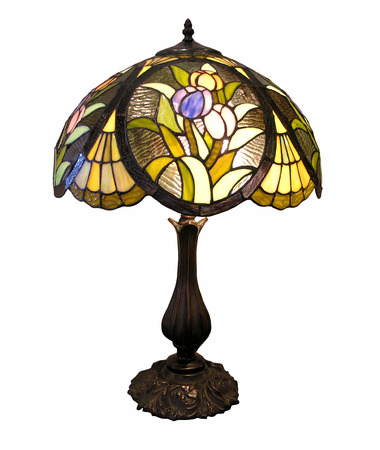 home accents: An old table lamp with decorative glass shade