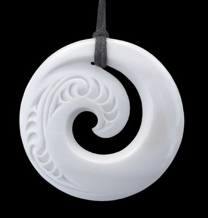 Modern Maori koru design bone pendant Stock Photo