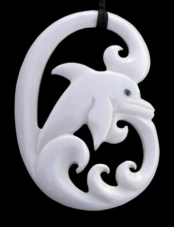 A dolphin pendant carved from bone