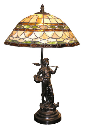 home accents: An antique table lamp with a boy with basket on the base