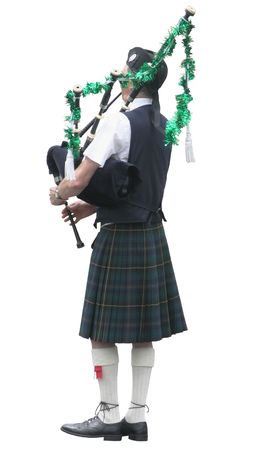 A piper with his pipes decorated for the  season