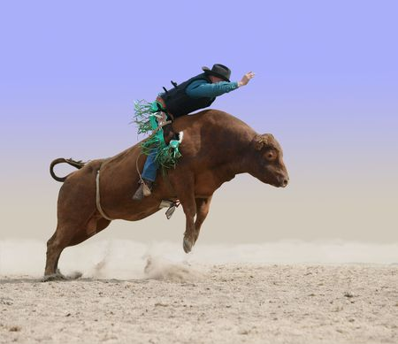 Cowboy on a Red Bull   Stock Photo - 6082652