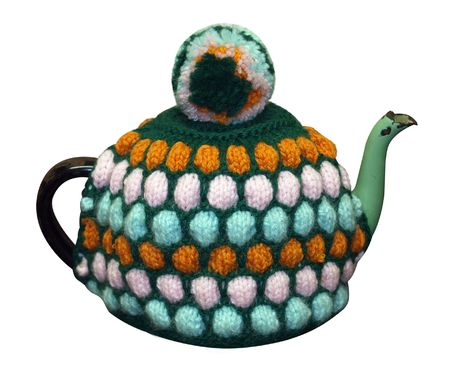 cosy: Teapot with knitted cosy isolated   Stock Photo