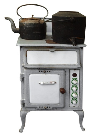 oven range: Antique Stove with Pot Kettle isolated  Stock Photo