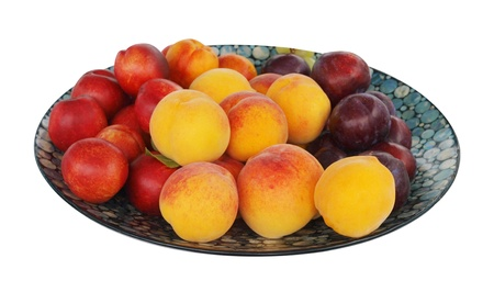 Paua Inlaid Dish wuth Plums, Peaches and Nectarines isolated Stock Photo - 13084249