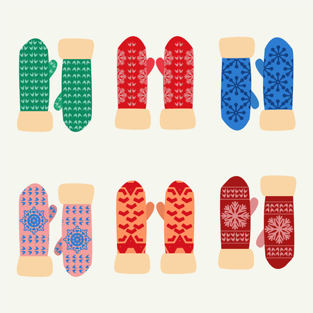 mittens: Cute set with mittens. Vector Colorful collection of different knitted  winter mittens with snowflakes patterns