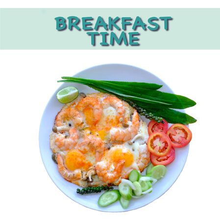Fried eggs and shrimps decorate with fresh vegetables top view isolated with inscription breakfast time.