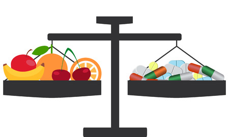 synthetic: The choice between natural and synthetic vitamins. Scales with pills and fruits.