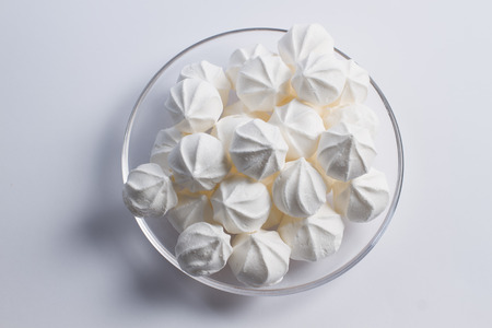 kiss biscuits: Air crisp white meringue on a white background Stock Photo