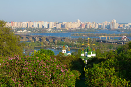 Beautiful spring landscape with views of the city. Orthodox Church in the park. Stock Photo