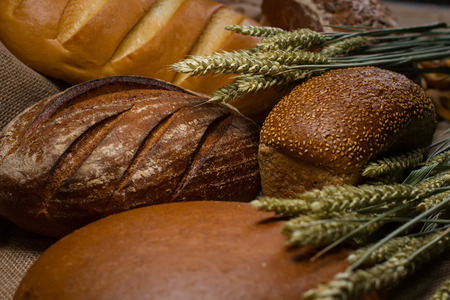 Bread still life with wheat spikelets on sackcloth