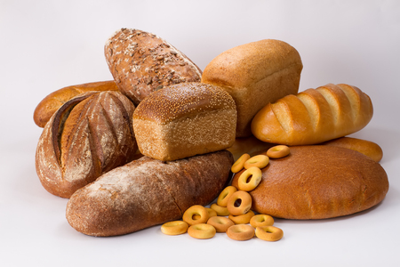 baton: Assortment of different types of bread isolated on white background