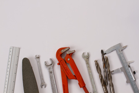 assorted work tools on white background