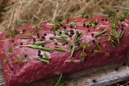 Raw beef marinated in spices. Meat close-up. Stock Photo
