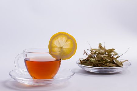 Dried linden and linden tea with lemon. Stock Photo