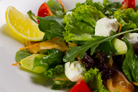 Salad with salmon close-up. Ingredients of salad. Stock Photo