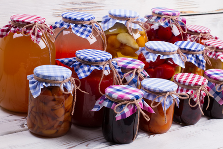 colored bottle: Beautiful jars of preserves. Glass jars with canned food. Stock Photo
