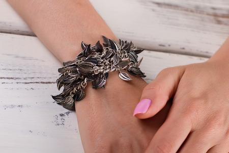Womens accessories. Beautiful metal bracelet in the form of leafs. Reklamní fotografie