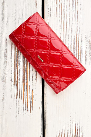 varnished: Beautiful red lacquer purse. Female red clutch. Stock Photo