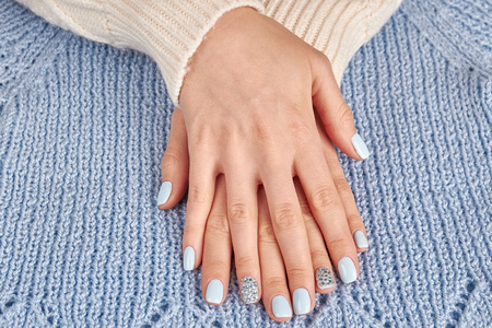 Beautiful well-groomed female hands close up. Womens hands with a stylish manicure.
