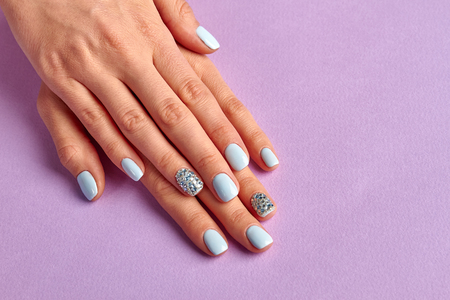 Nail Art Concept Female Hands With Neat Manicure On Violet