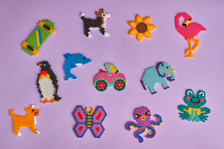 pink dolphin: Beautiful childrens figures on a purple background. Childrens games from different toys. Homemade toys for children. Childrens background.