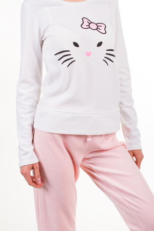 Young girl in pajamas on white background. Beautiful soft pink pajamas with a cat.