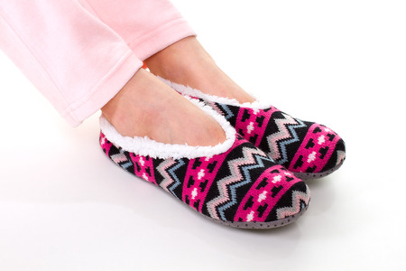 Female feet in slippers. Soft, bright, cozy slippers.