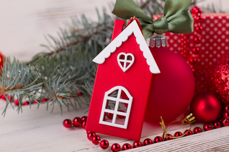 Red and white house figurine. Cute ornaments for Christmas tree. Spruce up your holiday decor.