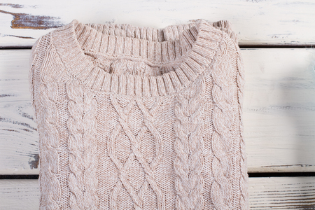 Winter sweater close-up. Large openwork knitting.