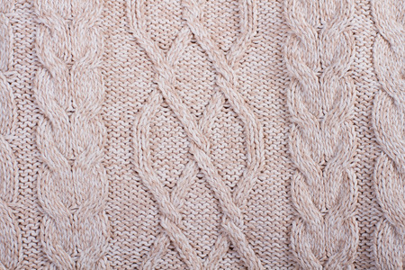 Clean beige knitted wool fabric as a background. Stock Photo