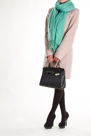 Female model with leather purse. Black handbag and turquoise scarf. Stock Photo