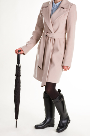 Fashionable girl in rubber boots with umbrella.