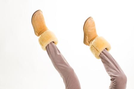 Funny Australian womens shoes on legs.
